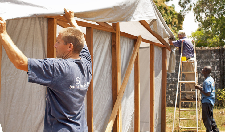 Samaritan's Purse staff construct a triage unit for Ebola patients.