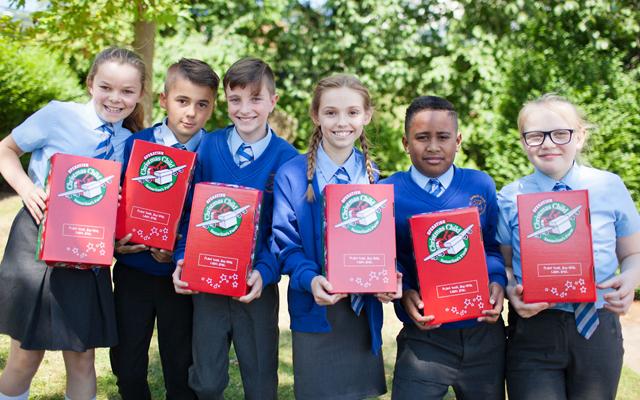 School Children with shoeboxes