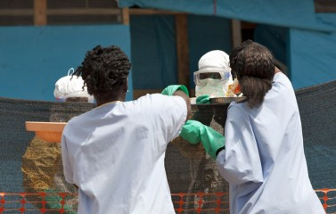 Medical team members must wear personal protective equipment to treat patients with Ebola