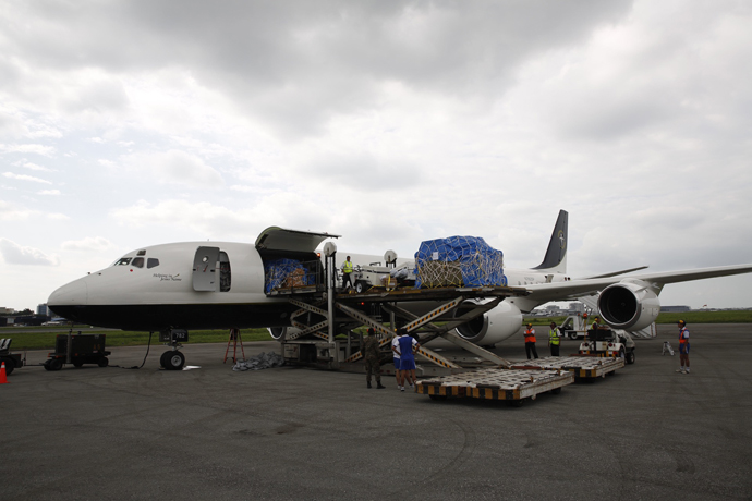 Our DC-8 has already arrived safely in Ecuador (April 20). Equipment is being unloaded for the emergency field hospital.