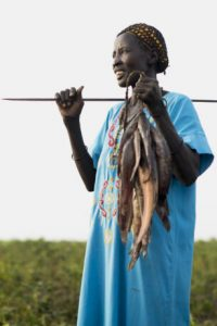 Regina, farms and fishes in Aweil. SP provided seeds, tools and training for this community farm