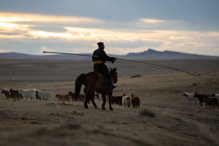 Horsemen are a common sight on the grasslands of Mongolia's Tuv Province.