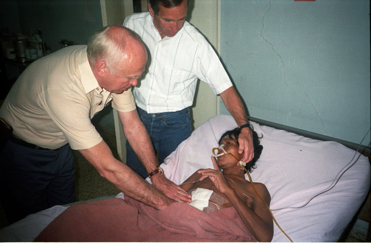 Drs. Lowell (left) and Richard (right) Furman see a patient in Honduras