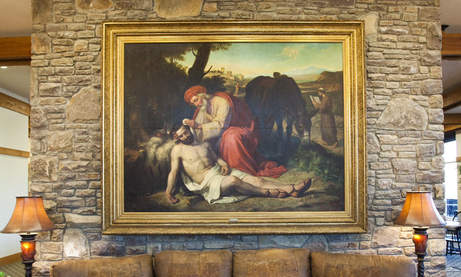 """La Caridad del Samaritano"" literally translated, ""The Charity of the Samaritan"" is an oil painting by Spaniard Jose Tapiro y Baro (1863-1913) depicting the story of the Good Samaritan from Luke 10:30-37. A gift to Samaritan's Purse in 2011 from the Gamboa Family Trust, the work of art is a reminder to all of Christ's followers to ""Go and do likewise."" This painting hangs at the entrance to the Furman Building at the ministry's international headquarters in Boone."