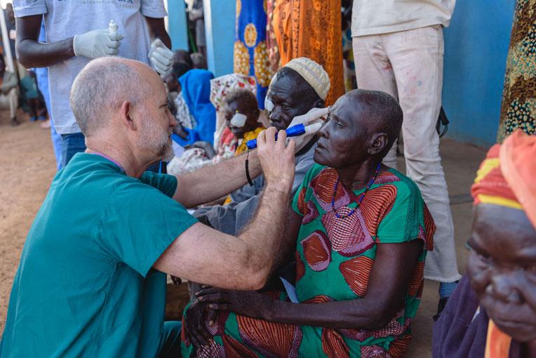 Dr. Dan Gradin checks Chaka's vision after surgery.