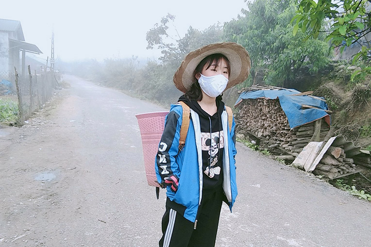 A Hoa Sua student wears her mask for protection.