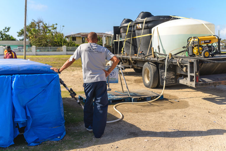 Samaritan's Purse fills the 2,000-gallon tank outside of First Baptist Church with freshwater once a day.