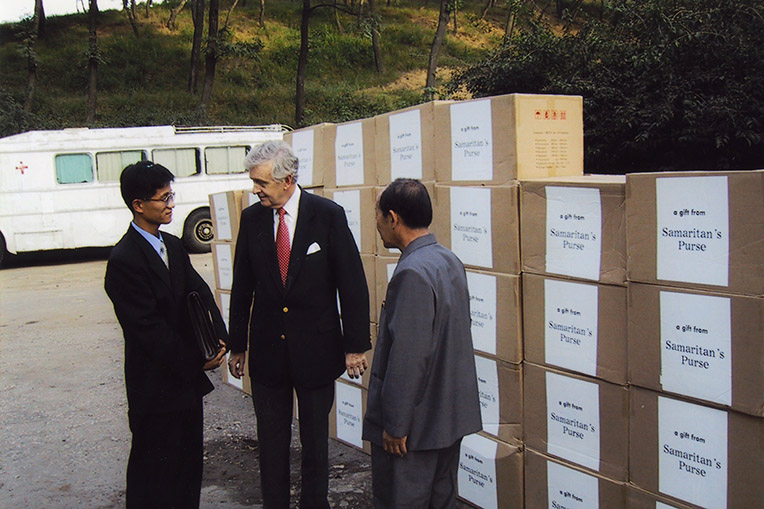 amaritan's Purse Board Member Dr. Melvin Cheatham presents medical supplies to a delegation in North Korea.