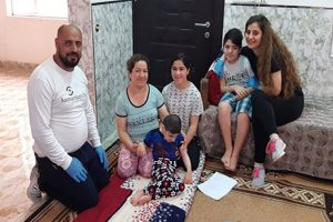 Miriana's son (in blue) needs to visit his doctor in Erbil, but can't because of the nationwide lockdown measures. The family is comforted by the assistance they received from Samaritan's Purse.