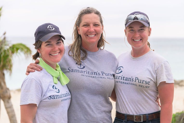 Tyra, Kathleen, and Veronica Esterly enjoy volunteering together with Samaritan's Purse.