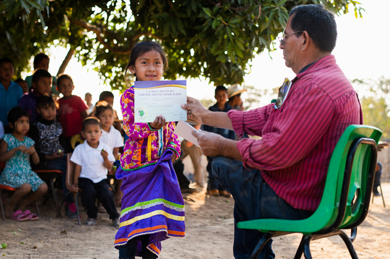 "LIDIA, 6, WALKED A MILE TO LA LAGUNA TO ATTEND THE GREATEST JOURNEY CLASSES, INCLUDING A GRADUATION CEREMONY WHERE SHE RECEIVED A BIBLE. HER FAVORITE VERSE IS, ""LET THE LITTLE CHILDREN COME TO ME"" (MATTHEW 19:14)."