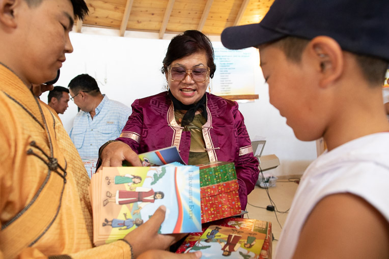 TUYA DELIVERS SHOEBOX GIFTS TO REMOTE AREAS AS PART OF HER CHURCH-STARTING EFFORTS.