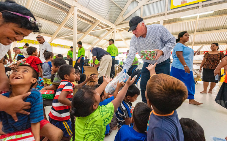 SAMARITAN'S PURSE PRESIDENT FRANKLIN GRAHAM HANDED OUT OPERATION CHRISTMAS CHILD SHOEBOX GIFTS IN KIRIBATI.