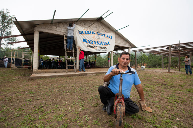 PASTOR JOSE USES A SCOOTER TO TRAVEL TO THE CHURCH WHERE HE IS SEEING DOZENS OF CHILDREN LEARN ABOUT GOD'S LOVE FOR THEM.