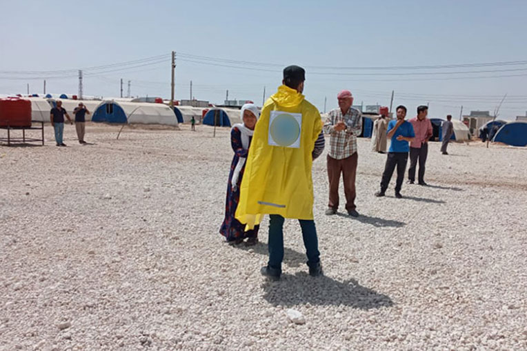 Syrians practice social distancing while waiting in line for monthly food rations from Samaritan's Purse partners.
