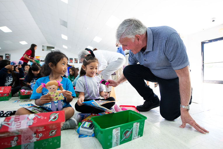 FRANKLIN GRAHAM VISITED WITH CHILDREN IN SAIPAN EARLY IN 2020 BEFORE CORONAVIRUS WAS DECLARED A WORLDWIDE THREAT. GRAHAM HAS A BOLD VISION TO DELIVER GIFT-FILLED OPERATION CHRISTMAS CHILD SHOEBOXES TO THE PACIFIC ISLANDS UNTIL EVERY CHILD THERE IS REACHED.