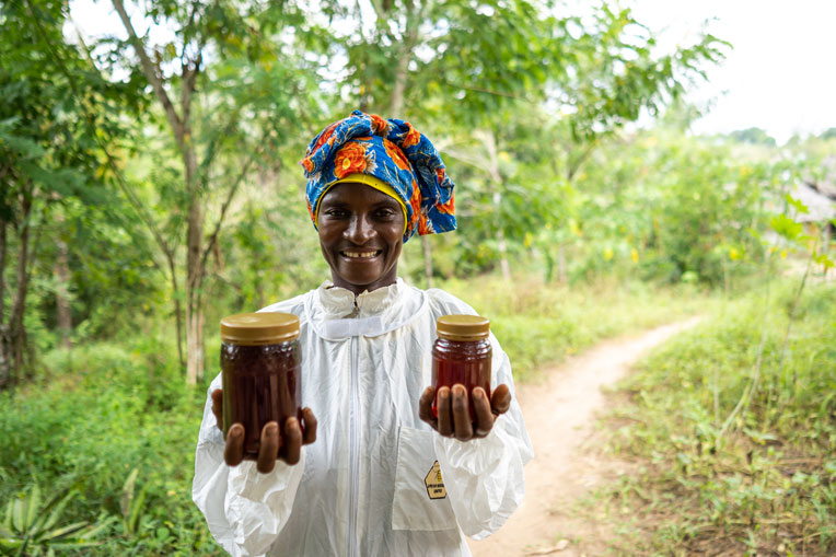 Chizi enjoys harvesting and selling her honey.