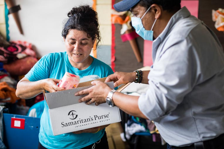 """After receiving a Samaritan's Purse hygiene kit, Gloria said, """"It makes me very happy. There's toilet paper, soap, gel, towels, and toothbrushes. It's very good."""""""