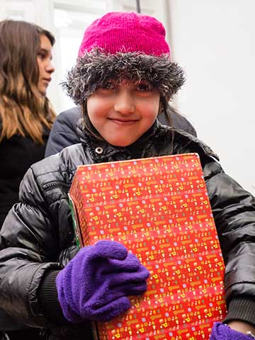 girl holds shoebox tight
