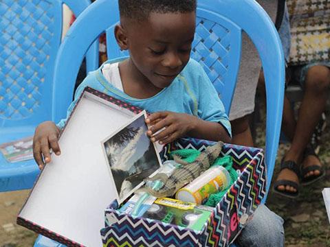 Boy with shoebox in Nigeria