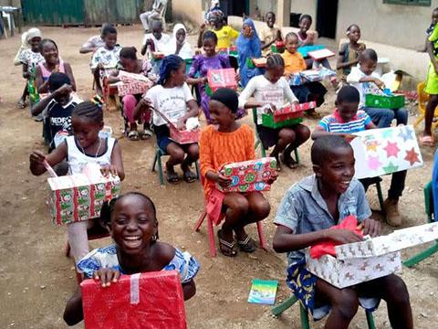 children receive shoebox gifts